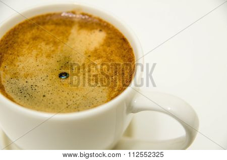 Cup Of Coffee With Crema Closeup Isolated On White