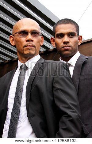 Two Businessmen standing outdoors
