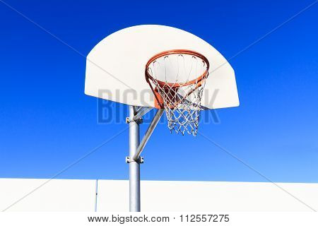 White Basketball Backboard with Blue Sky