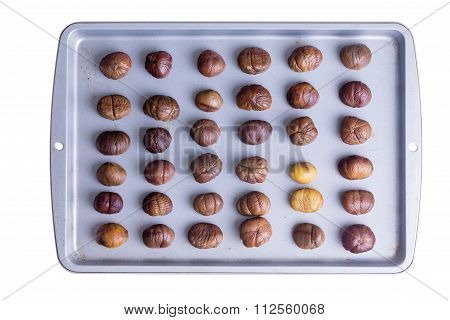 Whole Roasted Chestnuts On A Roasting Tray