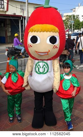 Mascot Dressed Up As A Cherry Tomato