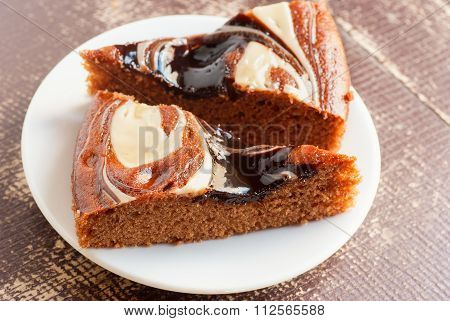 Pieces Of Chocolate Cake Cake On A White Plate