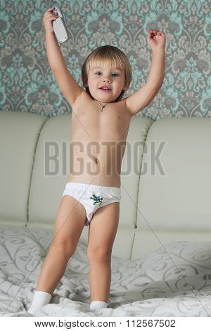 Boy Jumping On Bed