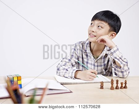 Asian Schoolboy Studying