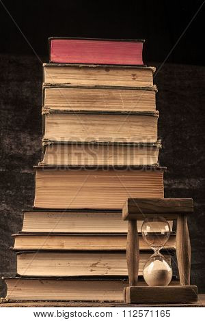 Hourglass And Books Pile