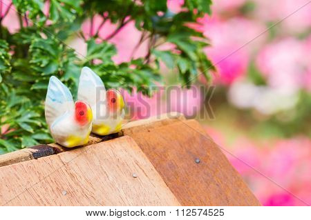 Old Small Retro Two White Chicken Ceramic On Plank Wood With Colorful Background, Selective Focus, L
