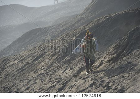 ourist trekking along Mount Bromo misty ridge