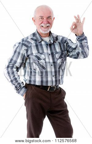 Happy old man smiling with white teeth showing OK gesture.