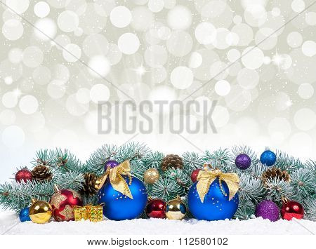Christmas Baubles And Blue Balls With Snow Fir Tree