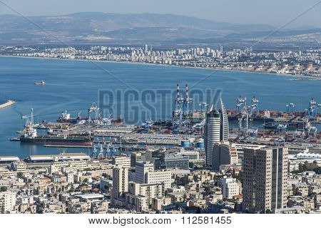 view from Mount Carmel to cityscape and port in Haifa
