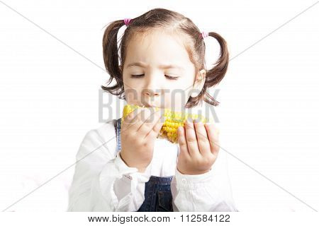 Portrait Of Happy Girl Biting A Corncob