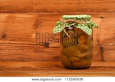 One Jar Of Pear Compote At Brown Vintage Wood Surface