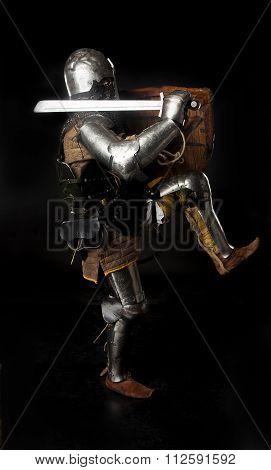 Medieval Knight In Full Armor Attacks
