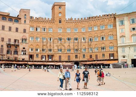 Tourists In Piazza Del Campo, Siena, Italy