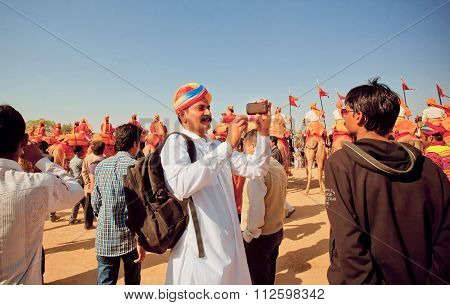 Two Indian Men Making Photo Portraits With Mobile Phone During The Desert Festival