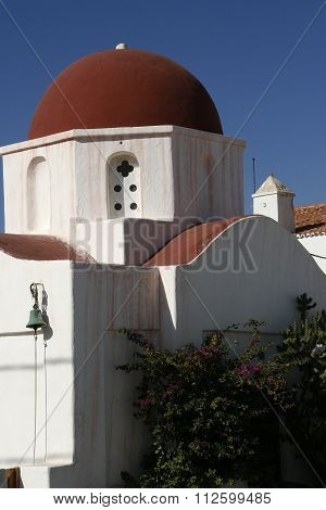 Traditional church in Greece with red domes