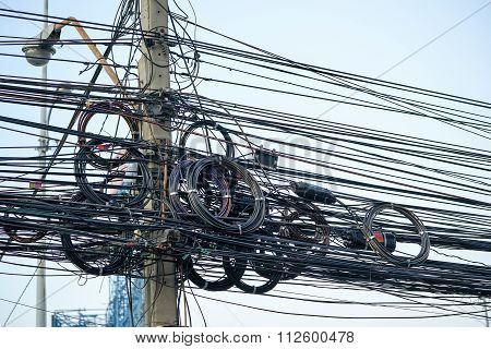 Messy Electrical Cables And Wires On Electric Pole