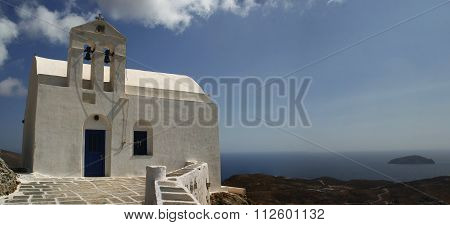 Traditional church in Greece with a bell. panorama