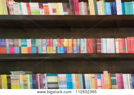 Blurred Books In Public Library. Blured Effect. Background