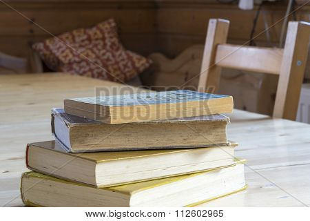 Pile Of Old Books On A Rustic Table