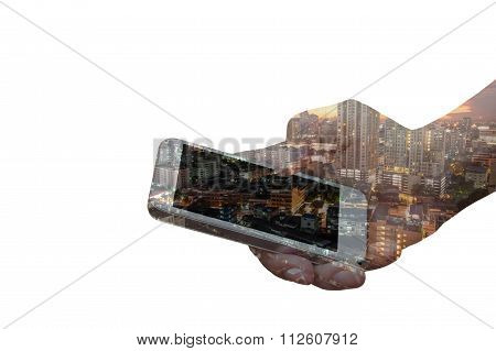 Double Exposure Of Hand Hold Smartphone Over Night City