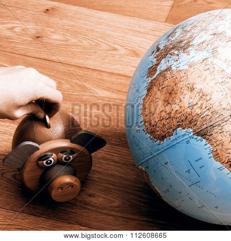 Money Box With Globe Of World