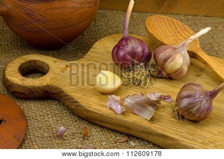 a clove of garlic and a head of garli
