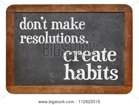 Do not make resolutions, create habits - advice on a vintage slate blackboard