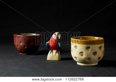 Wooden parrot and ceramic mug