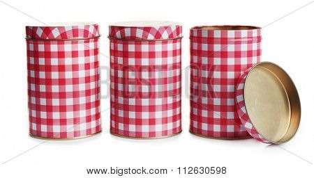 Three red and white checkered tin containers, isolated on white