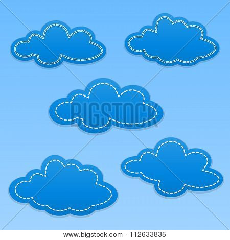 Set of cloud paper tags. Clouds with white dotted lines. Blue colored background.