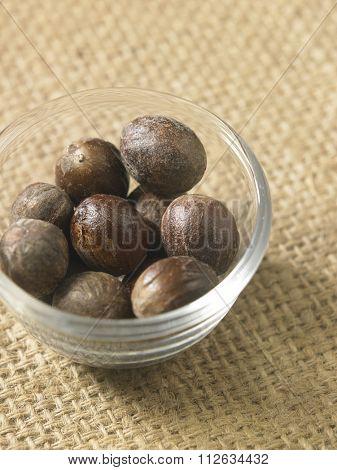 nutmeg on the burlap background