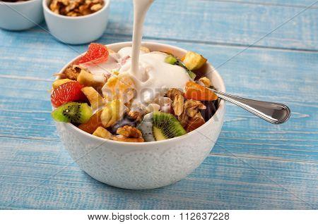 Fruit Salad With Yogurt And Nuts Closeup