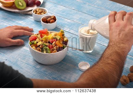 Man Eating Breakfast Fruit Salad With Yogurt