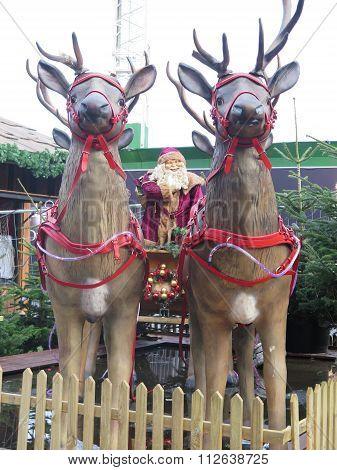 Santa And Raindeers