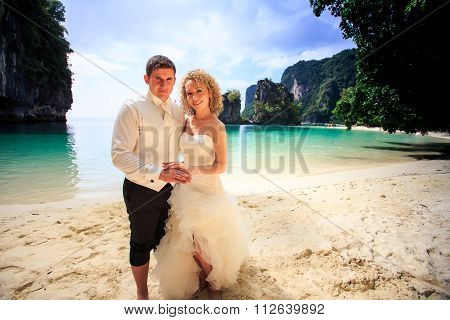 Closeup Groom Blonde Bride In Fluffy Stand Join Hands On Beach