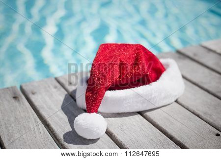 Santa hat by the swimming pool
