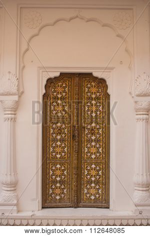 Traditional Brown Wooden Door With Ornate Stone Doorframe In Junagarh Fort, Bikaner