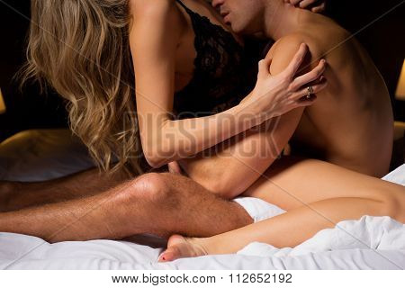 Woman sitting in mans lap