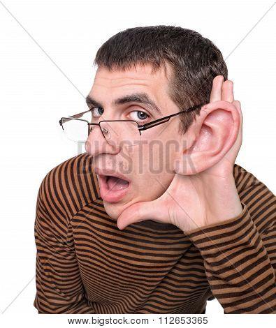 Man listening with big ear. Humor Creative.