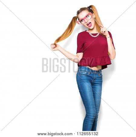 Surprised Teenage Gil holding funny paper glasses on stick. Joyful young woman ready for party, isolated on white background