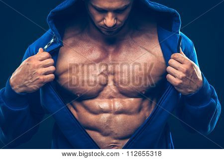 Man with muscular torso. Strong Athletic Men Fitness Model Torso showing six pack abs.