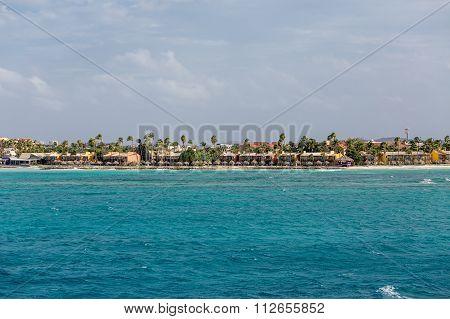 Coastal Condos And Resorts Under Palm Trees