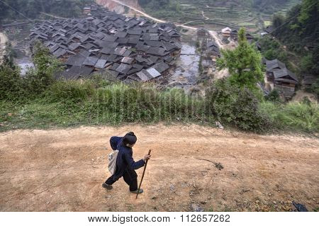 One Asian Woman Farmer Returns From Field Work.
