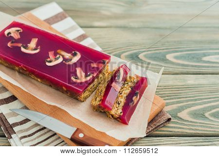 mushroom pate with cranberry jelly on wooden background