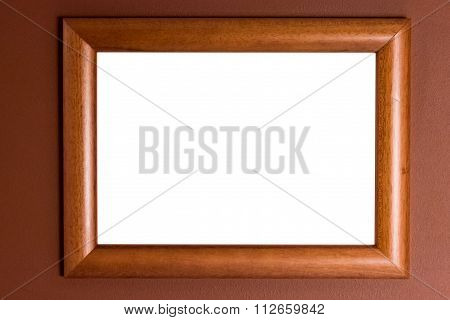 Wooden Picture Frame On The Wall With White Background