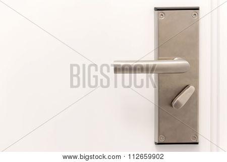 Door Metal Handle On The White Door