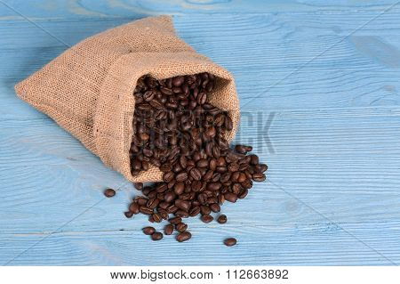 Bag Of Roasted Coffe Beans On A Blue Background