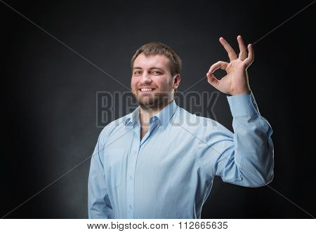 Smiling man showing ok hand sign
