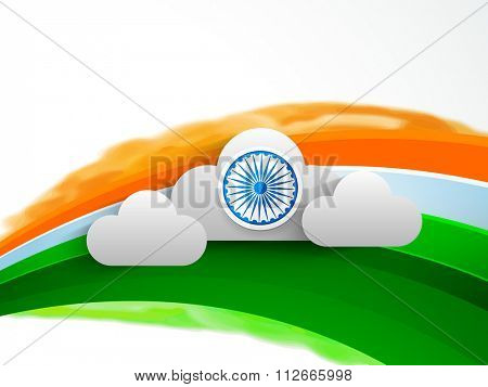Shiny Ashoka Wheel on clouds and tricolour waves decorated background for Happy Indian Republic Day celebration.